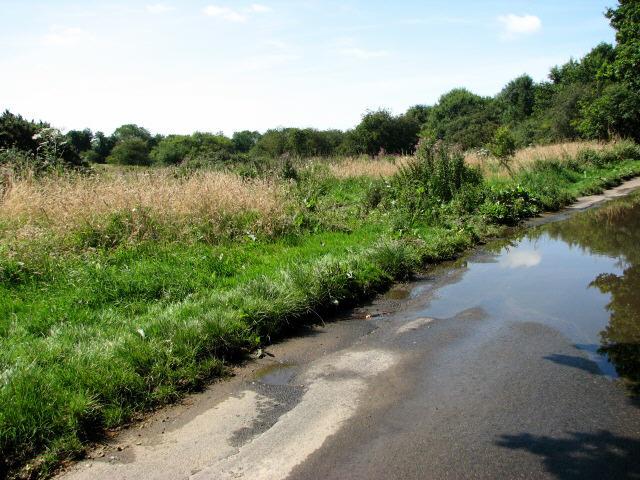 Thwaite Common, flooded road