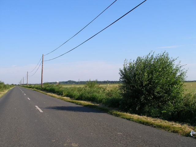 Telegraph lines stretch alongside the road