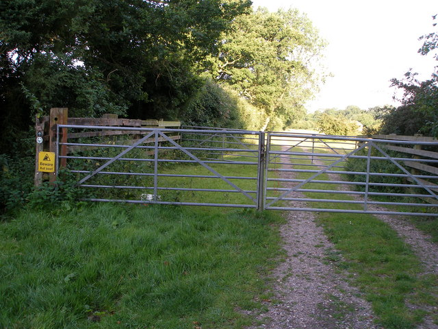 The footpath passes to the side of the gates