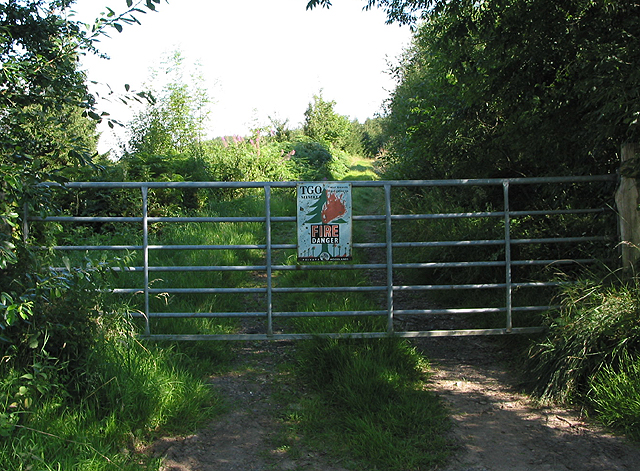 Gated entrance to private woodland.