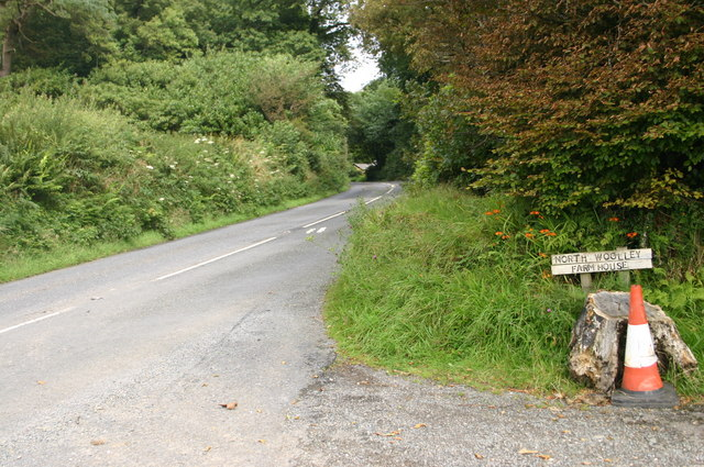 The A39 passes the entrance to North Woolley farmhouse