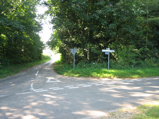 Road junction in woodland near Sparrow Green