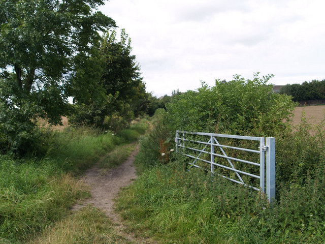 Gate to track at junction with footpath.