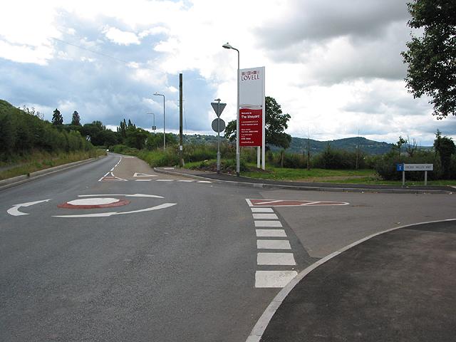 Mini roundabout to new housing estate