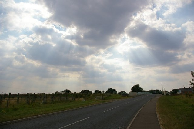 Scattering of sunlight by cloud over road