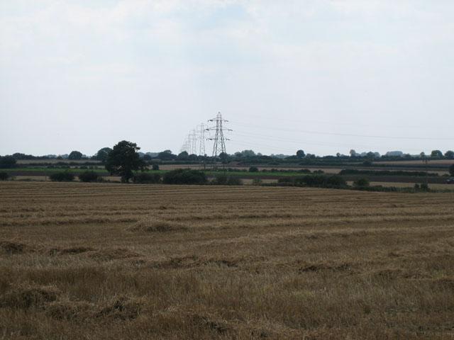 Pylons march across the harvest fields near Pear Tree Corner