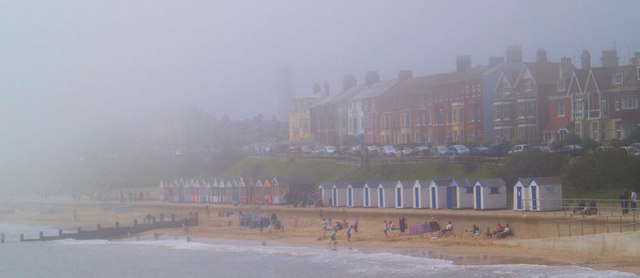 Sea fret masking the brightly coloured beach huts at Southwold..