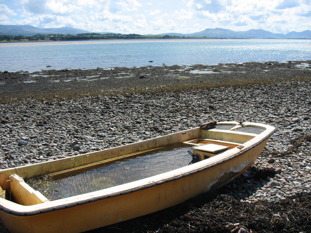 Water-filled boat on the beach