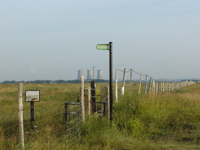 Footpath sign with disused power station in distance