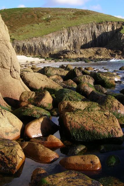 Sea-worn granite boulders exposed by low tide, Nanjizal bay