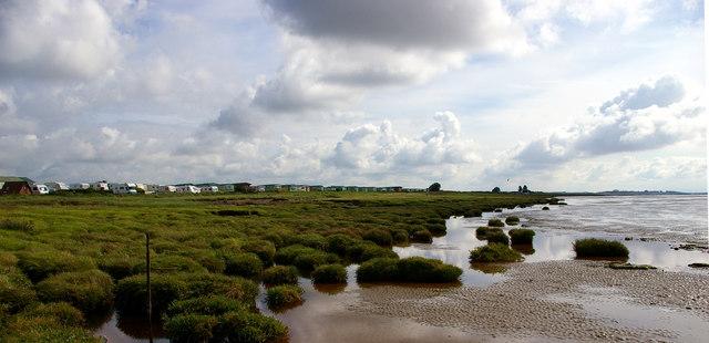 Caravan site at Riddindyke viewed from shore.