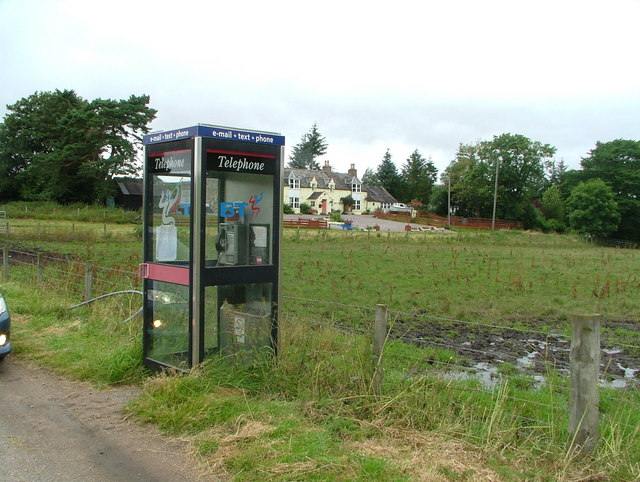 Telephone box at road junction