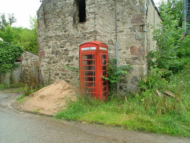 Telephone box & tumbledown farm building