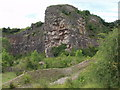 SJ2621 : Outcrops in Llanymynech limestone quarry by John Haynes