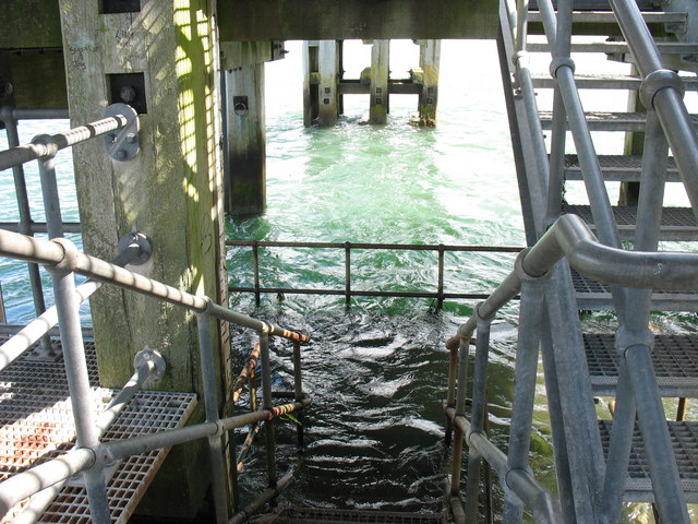 A fast ebb tide flows through the lower level of the Landerneau Pier