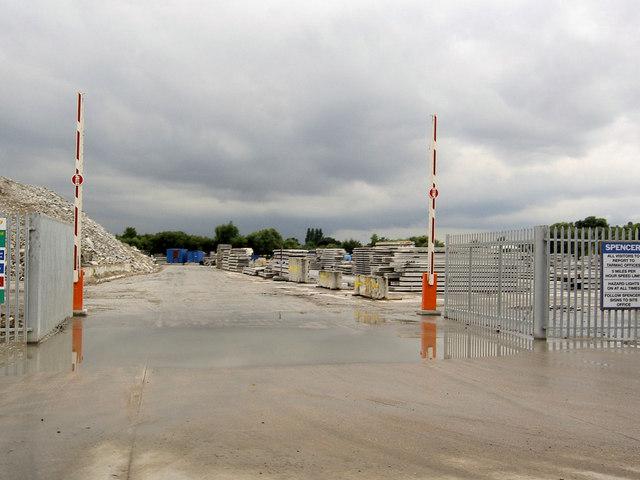 Gate into precast concrete yard.