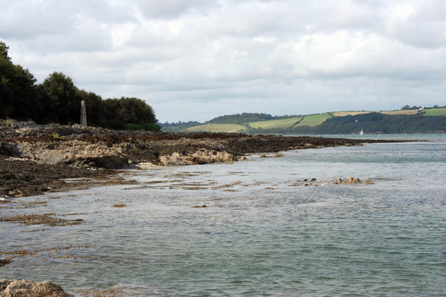 The rocky shore of the Carrick Roads