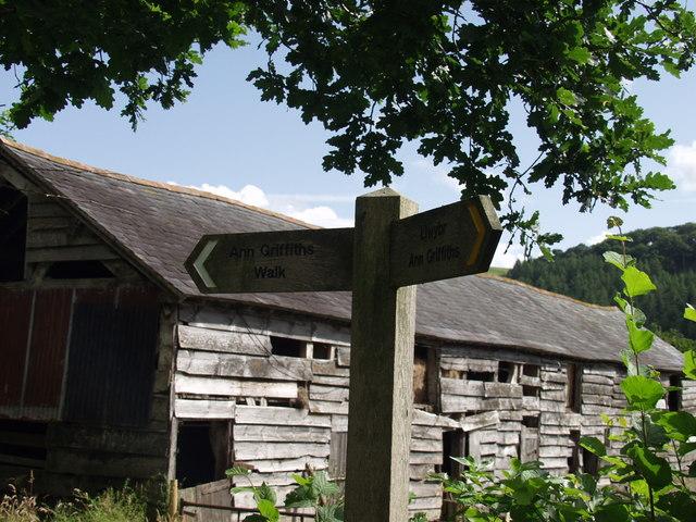 Timber barn and sign at Plas Dolanog