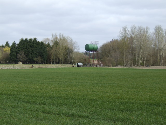 Water tower in a field