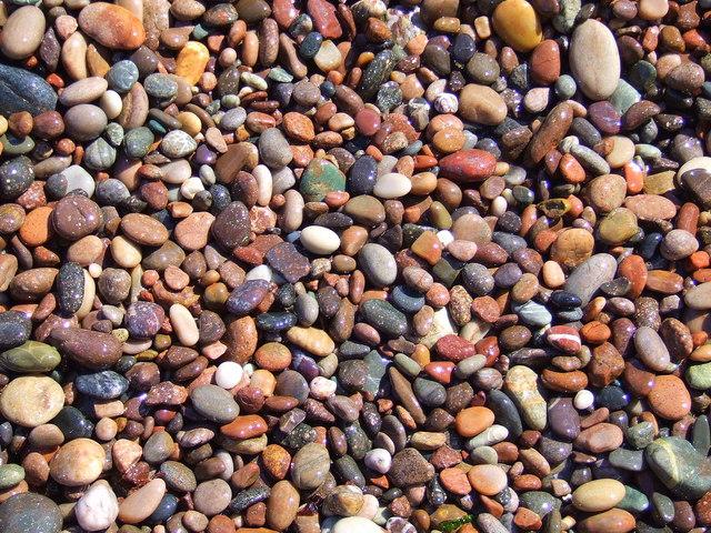 Wet pebbles on the shoreline, Auchmithie