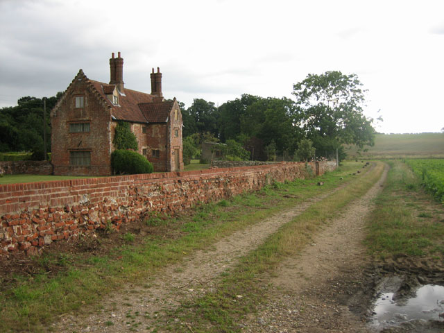 Handsome house beside the footpath, s. of Thurning