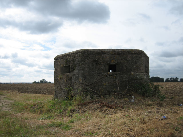 Pillbox and ploughed field near The Grove, Brandiston