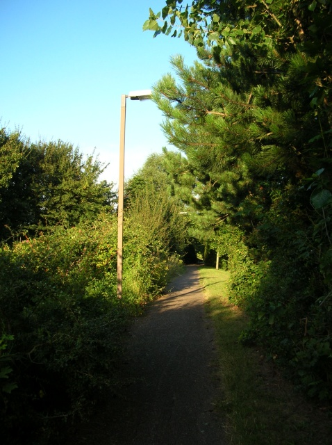 Path between golf course and road