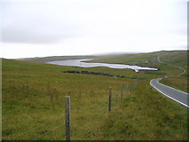 HU2849 : View down road past head of Scutta Voe by Ken Craig