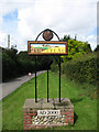 TG1334 : Plumstead village sign on Cherry Tree Road by Evelyn Simak