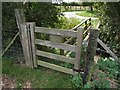 TF3264 : Field gate to St Andrews graveyard, Miningsby by Dave Hitchborne