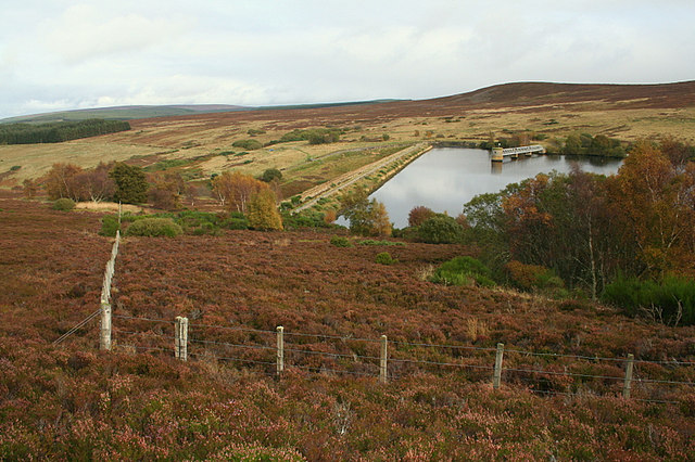 A view of the dam wall of Glenlatterach from the slopes of The Drum