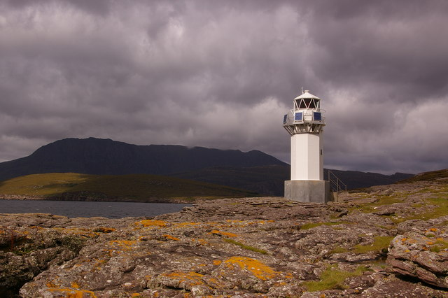 Rubha Cadail lighthouse with Ben More Coigach behind
