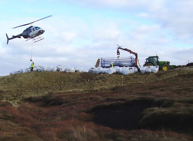 Transporting cut heather to repair the moor