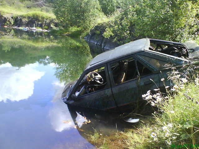 Abandoned Ford Escort in old quarry