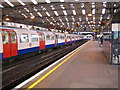 Dist:0.2km<br/>The station serves both the Bakerloo Line and London Overground trains. The original Baker Street and Waterloo Railway (hence Bakerloo) opened in 1906 to Baker Street and was extended here to Queen's Park in 1915. The service was then extended to Watford Junction, only to be subsequently terminated. Since 1989 Bakerloo Line trains have run northwards as far as Harrow and Wealdstone station. Here a southbound Bakerloo Line train is about to depart for Elephant & Castle. By a quirk of the geometry of the railway line, and demonstrating the schematic nature of the classic Underground map, northbound Bakerloo Line trains leaving Queen's Park for Kensal Green actually travel more southwards than northwards, whereas the map shows the line heading due north.
