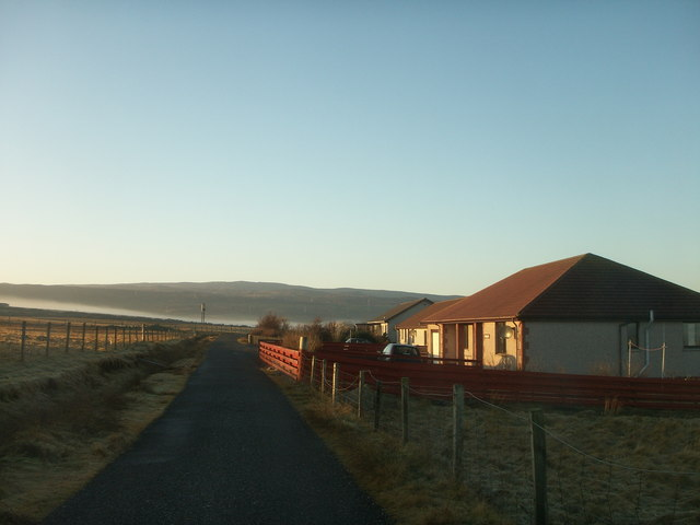 Single track road and houses at Wadbister.