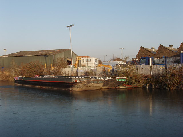 Wide dumb  barges on the frozen Grand Union Canal