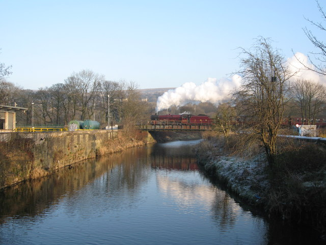 Steam train crossing the river Irwell