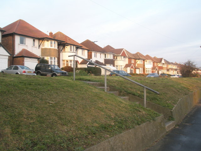 "Steps to houses approaching ""Rusty Cutter"" roundabout"