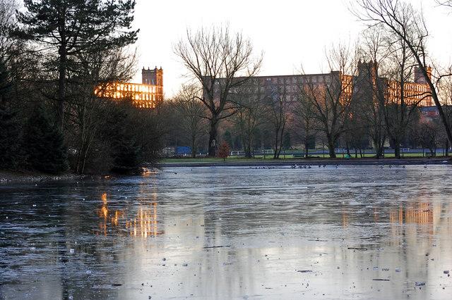 Mill scene across a frozen lake