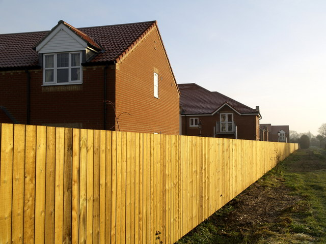 The Long and Straight Wooden Fence
