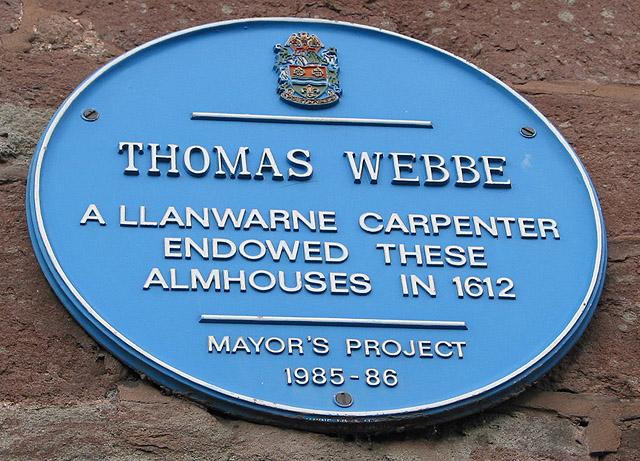 Blue plaque on the Webbe Almshouses, Copse Cross St.