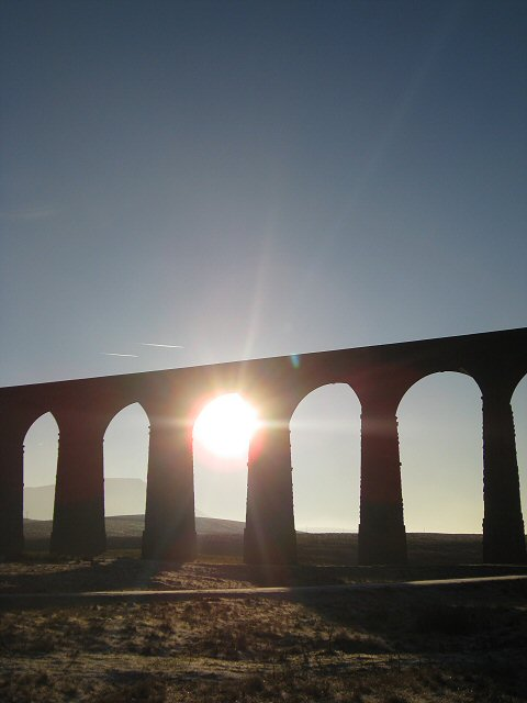 Winter sun bursting through the arches of the Ribblehead viaduct