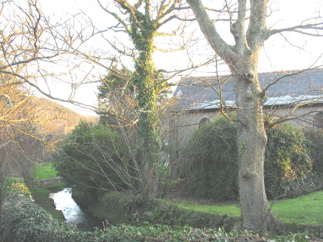A minor tributary of Afon Soch separating the St Cian churchyard and church hall