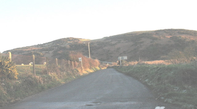 The road to Bont Newydd with Pen-y-Gaer hill fort in the background