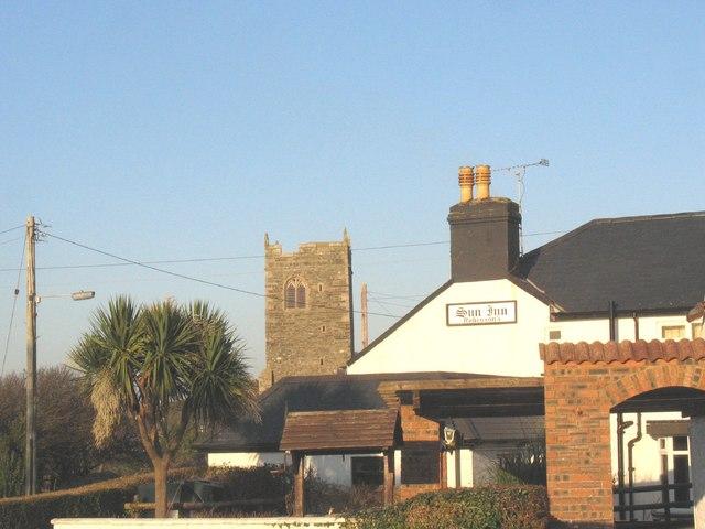 The Sun Inn and the tower of St Engan's Church, Llanengan