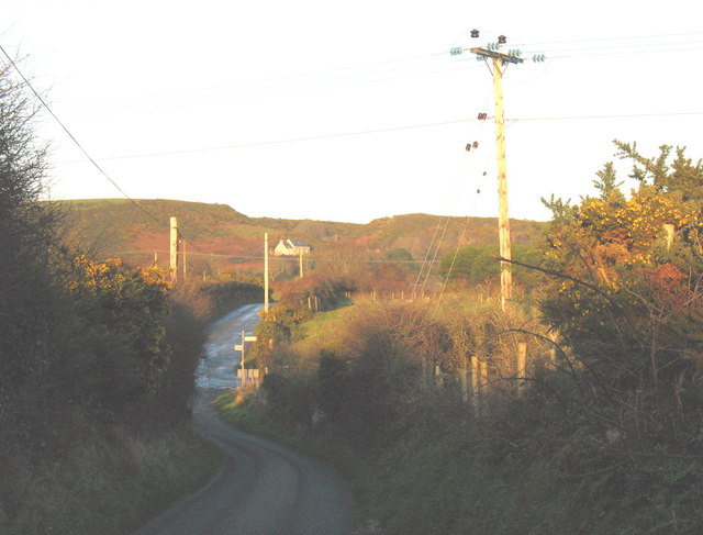 Approaching the T-junction north of Pen-y-Bont Farm