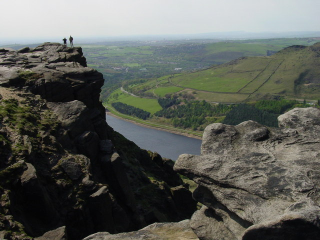 Walkers on Dean Rocks above Dovestone Reservoir