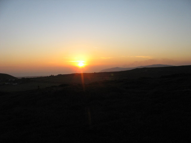 The sun setting between Foel Gron and Mynytho Common