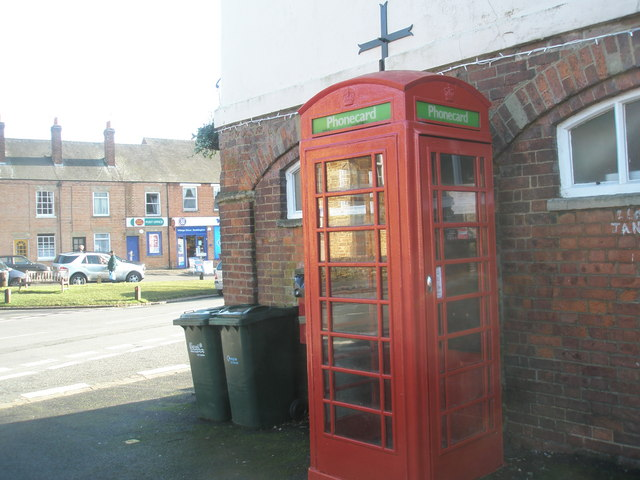 Looking past the phonebox towards the post office